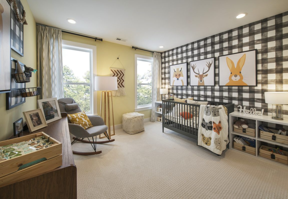 Baby's room highlighted by light, geometrically painted walls.