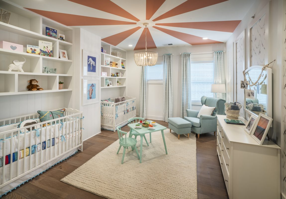 Nursery featuring spectacular two-toned ceiling and pendant lighting fixture.