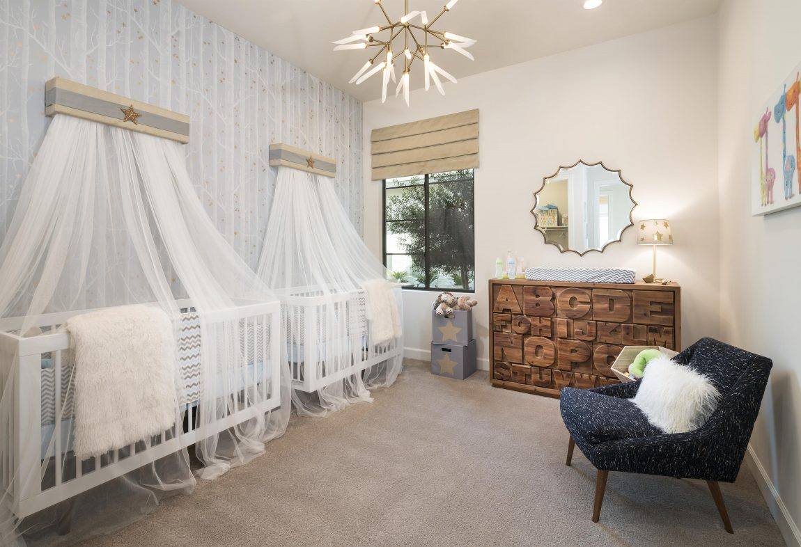 Dual cribs with decorative canopy display