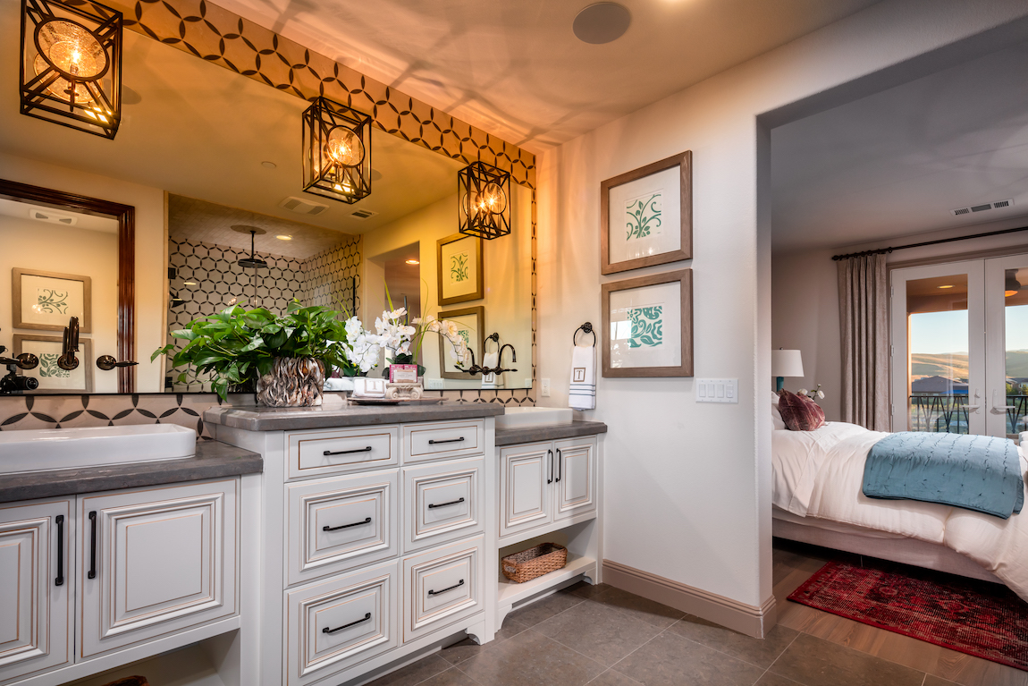 Dual vanity in bathroom with geometric patterns.