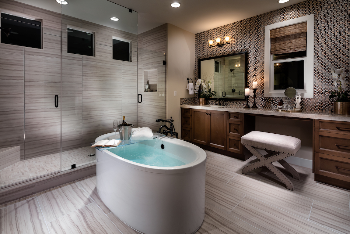 Soaking bath tub with makeup vanity.