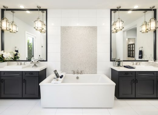White bathroom with center tub and double vanity.