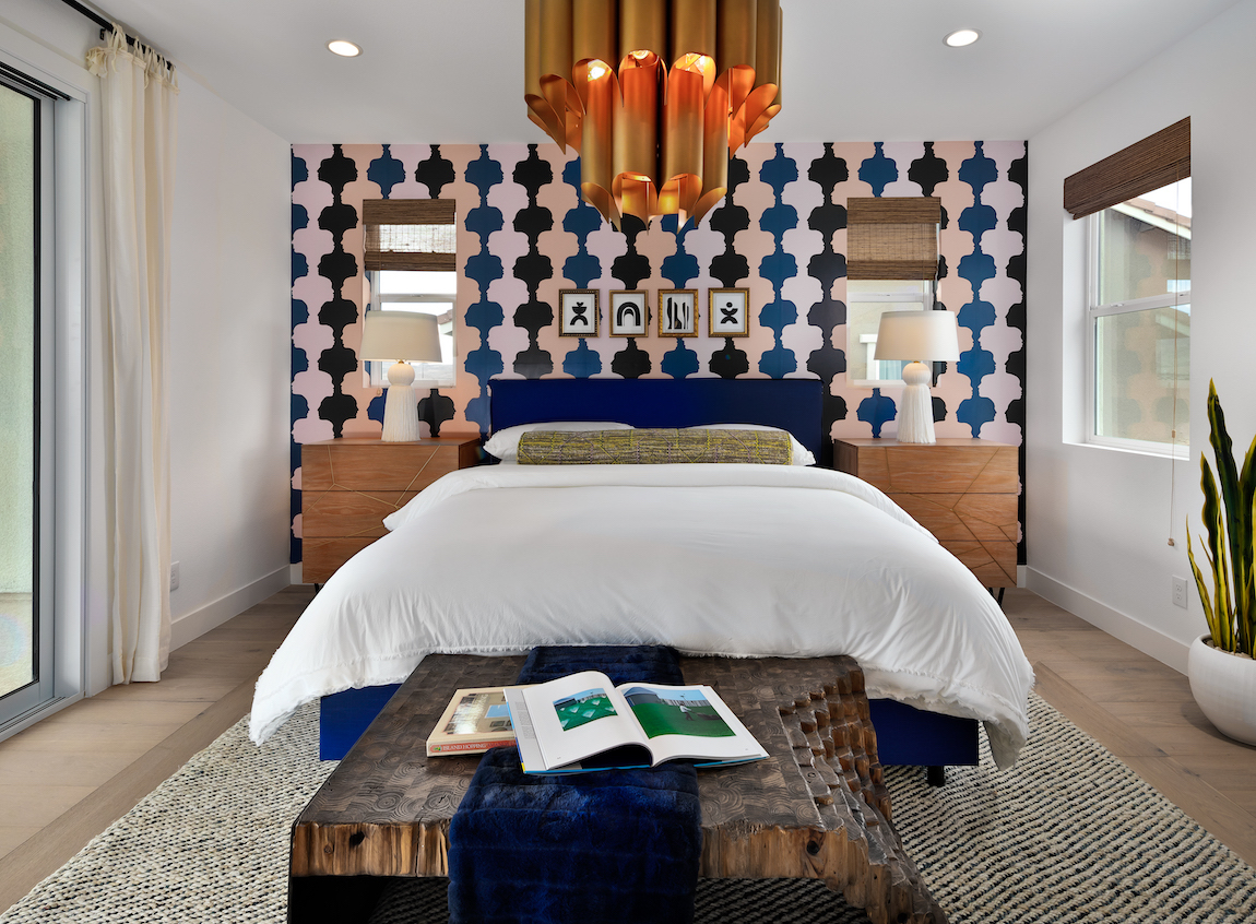 Teen bedroom showcasing exciting chandelier and eye-catching wallpaper design