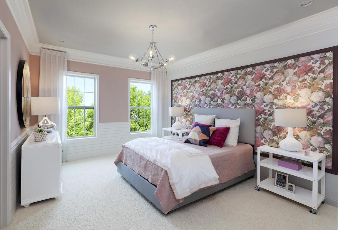 Teen bedroom highlighted by light tones and large floral artwork