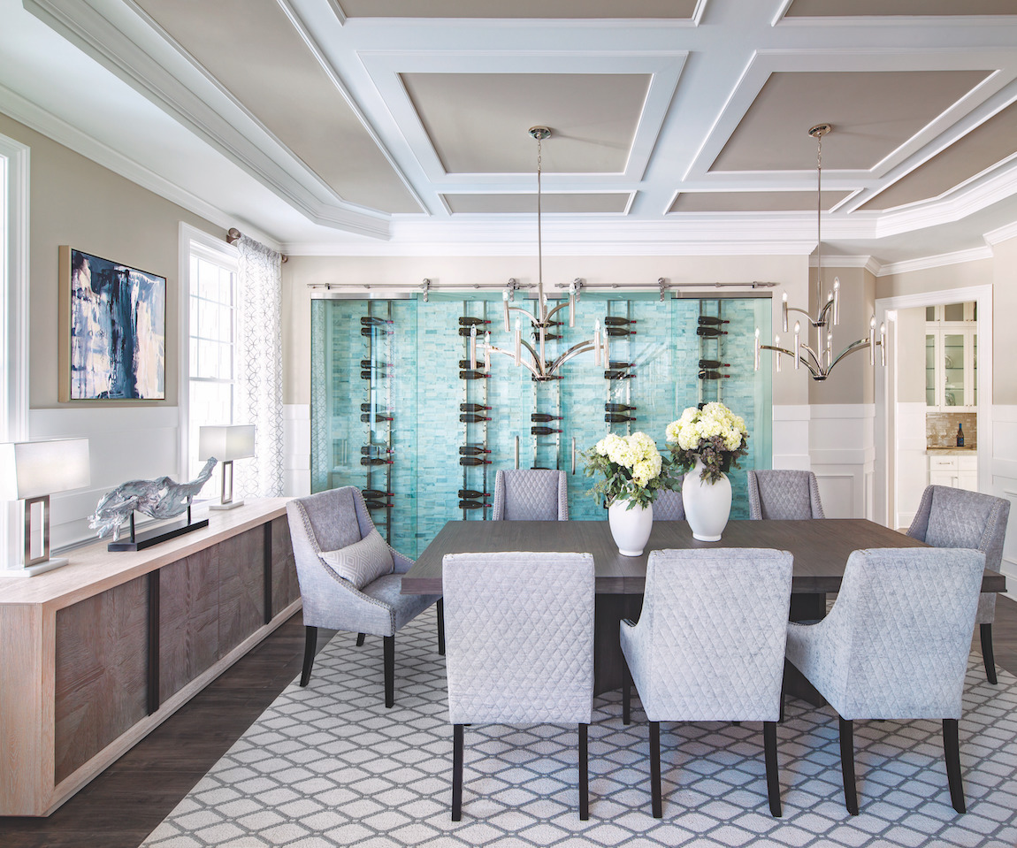 Dining room featuring tray ceiling and stunning wine wall.
