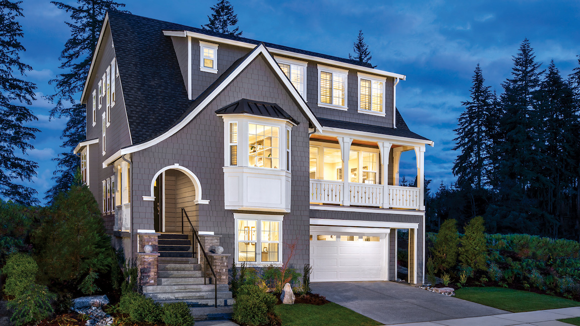 Gorgeous front exterior with balcony, garage, and covered entry
