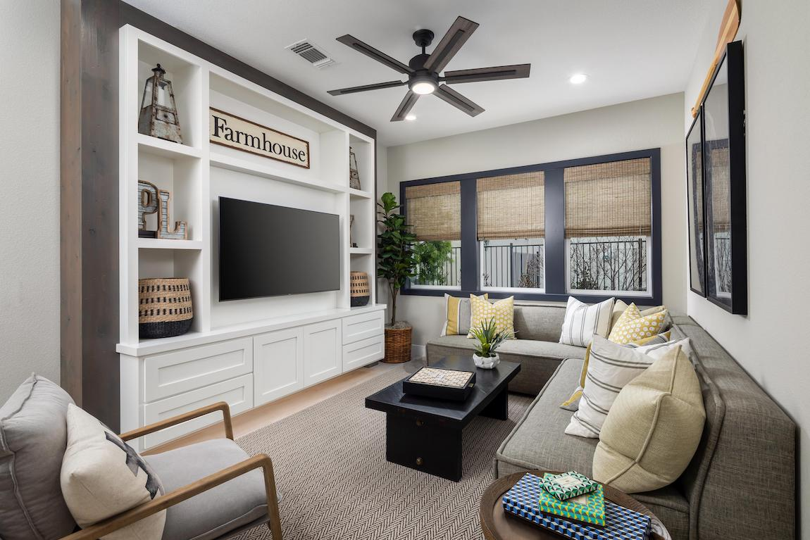Modern farmhouse living room featuring black accents and ample shelf space