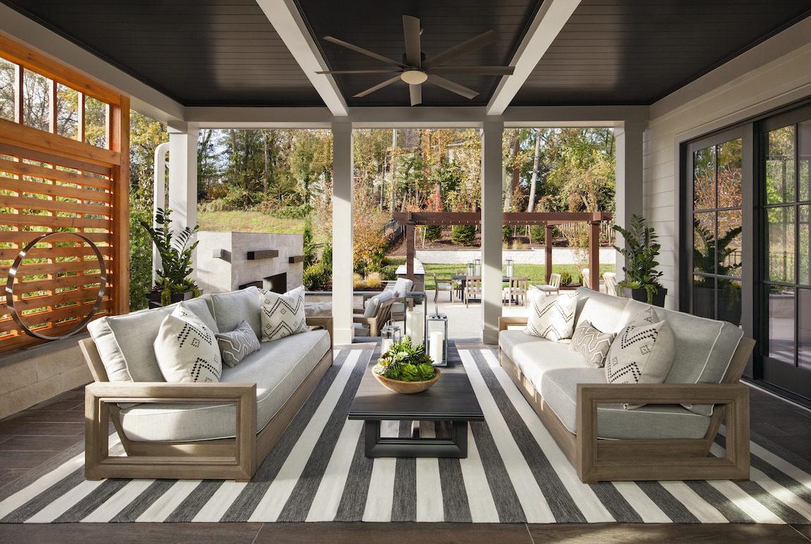 Gorgeous covered patio featuring lounge area and striped area rug