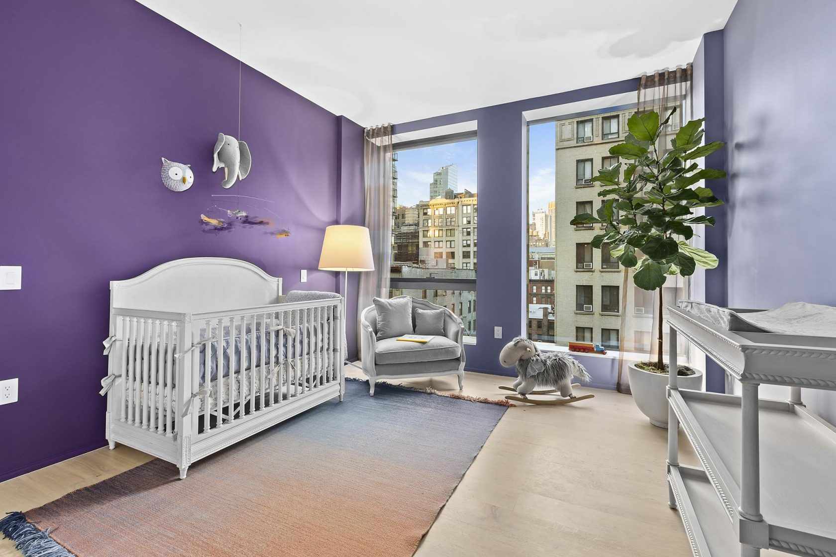 Baby room featuring a bold, vibrant purple color scheme