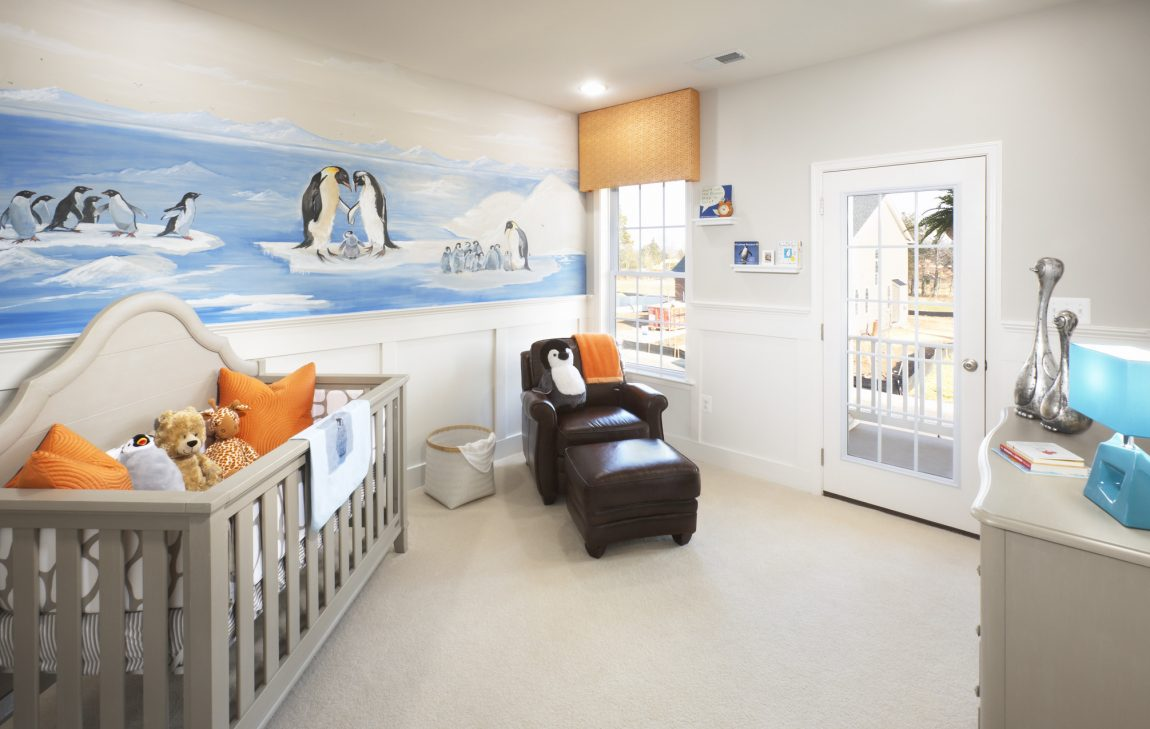 Nursery featuring crib that transitions into toddler bed.