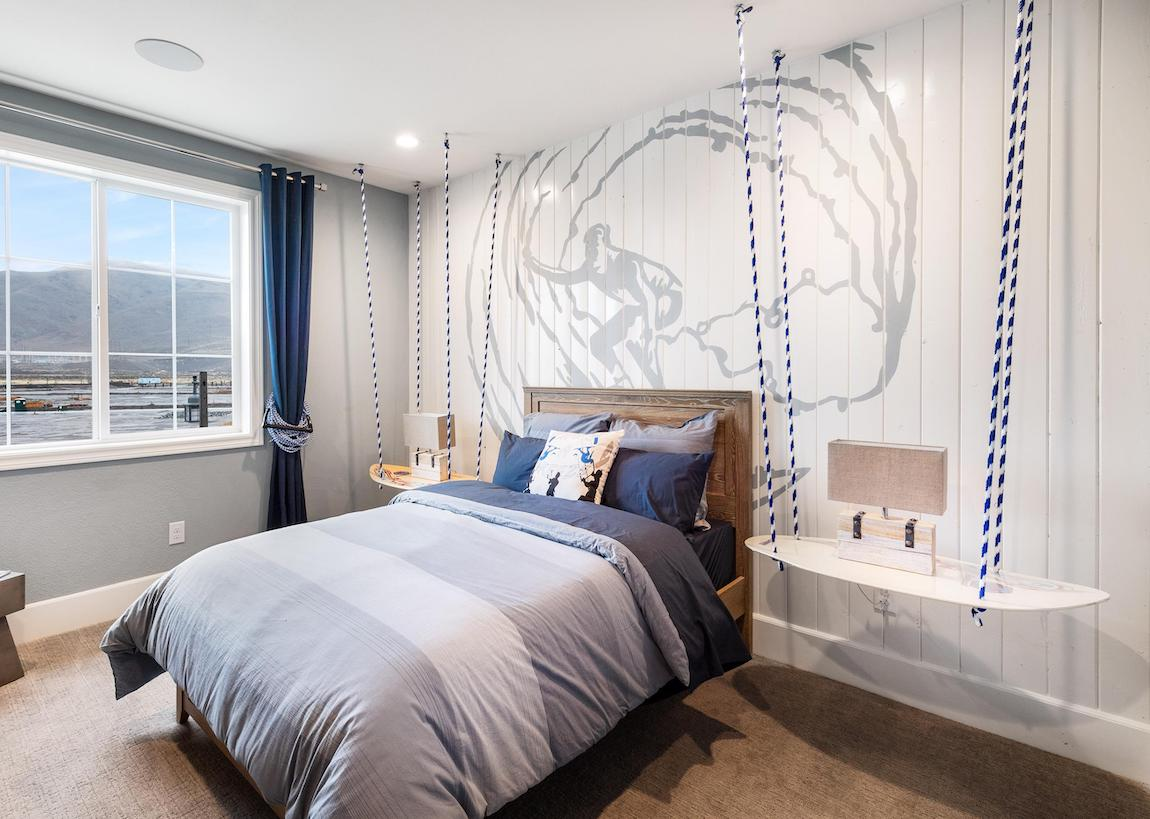 Teen bedroom with surfing theme highlighted by dual suspended nightstands