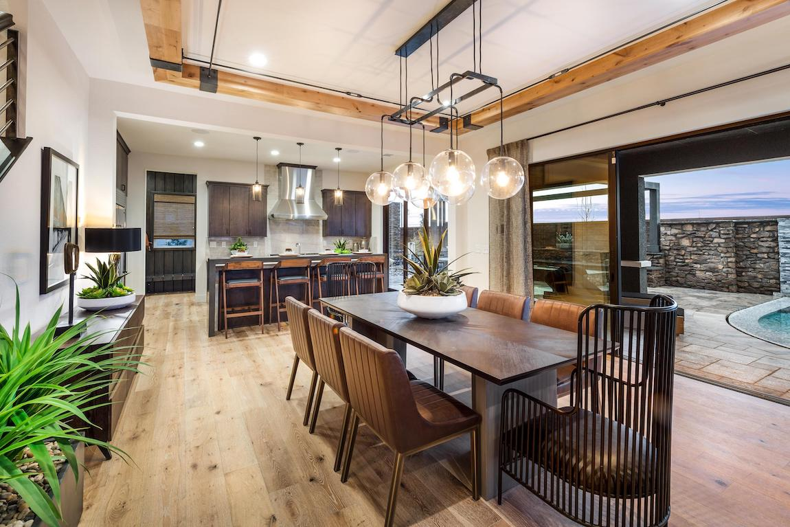 Dining area featuring varied seating options and globe pendant fixtures