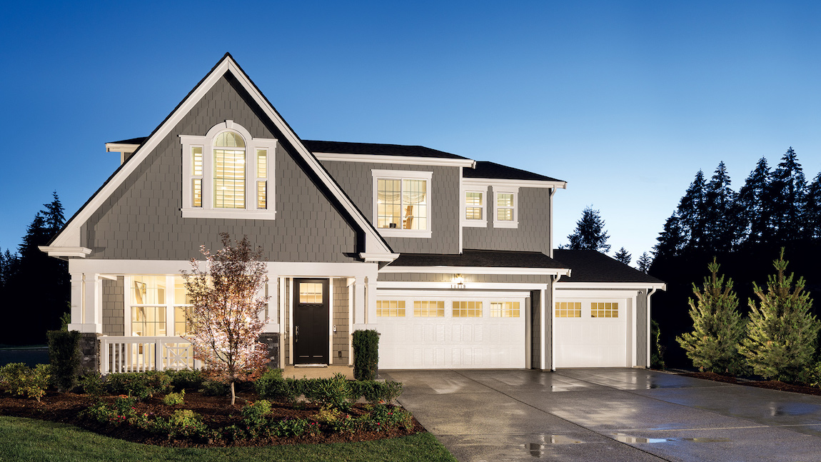 Luxe front exterior with dual garages and porch area