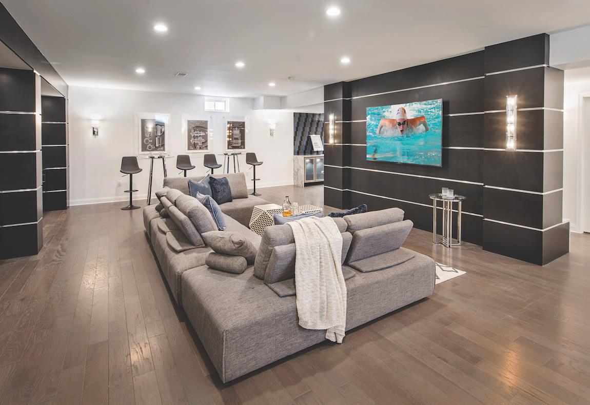 Basement home theater with central TV and ample couch space