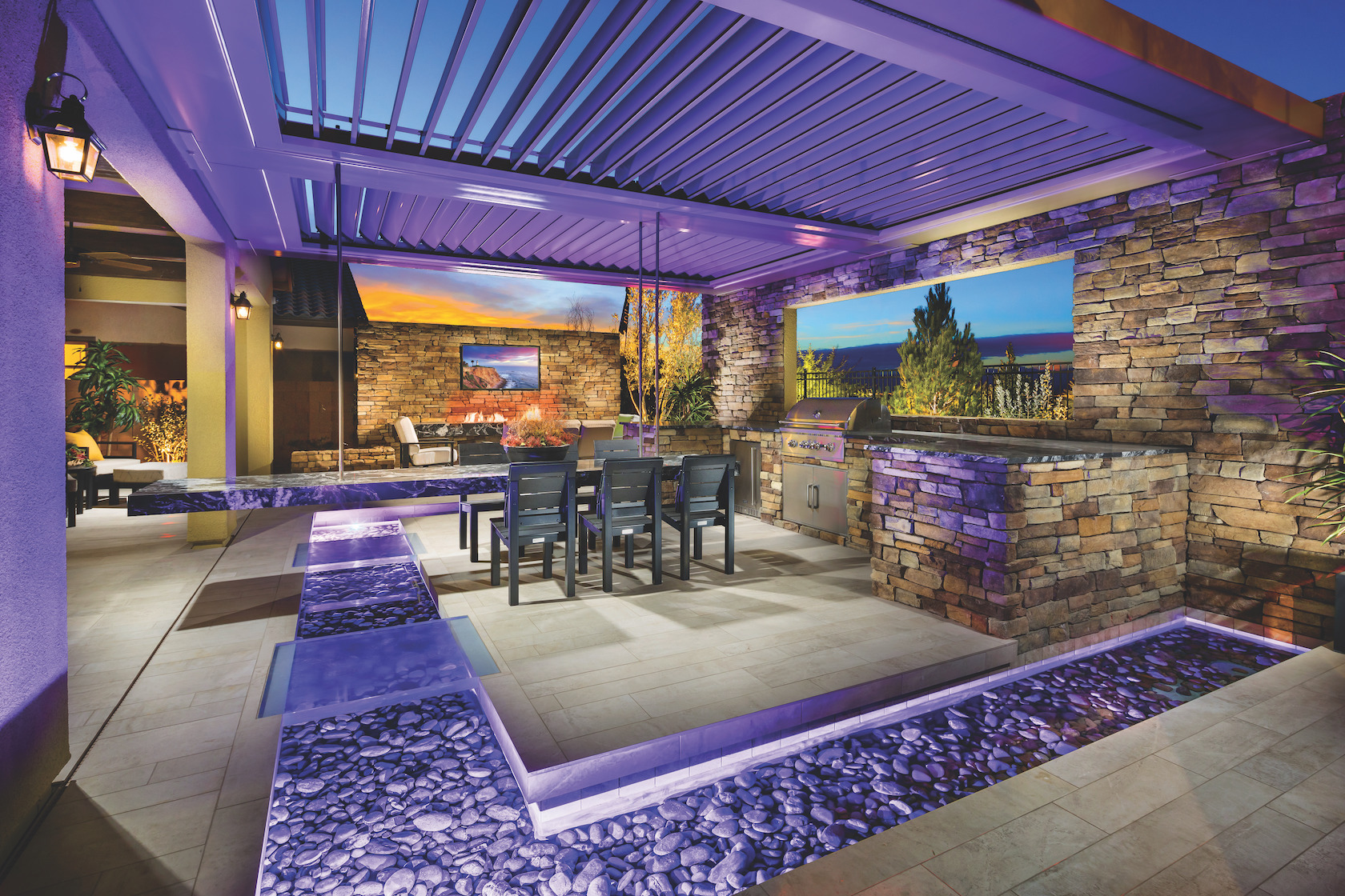Tremendous outdoor dining space with purple accent lighting