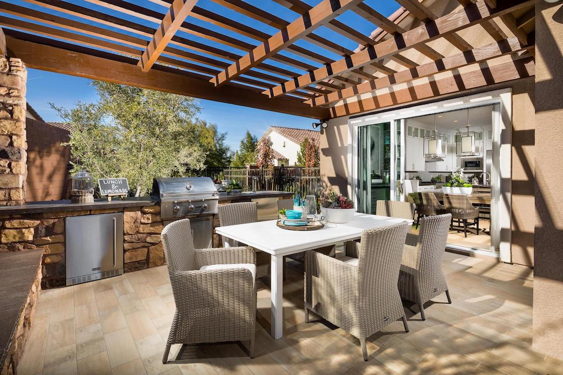Patio featuring grill and outdoor dining table