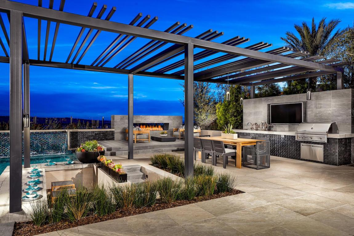 Luxury patio with multiple features including dining area with tv, fireplace lounge, and poolside bar