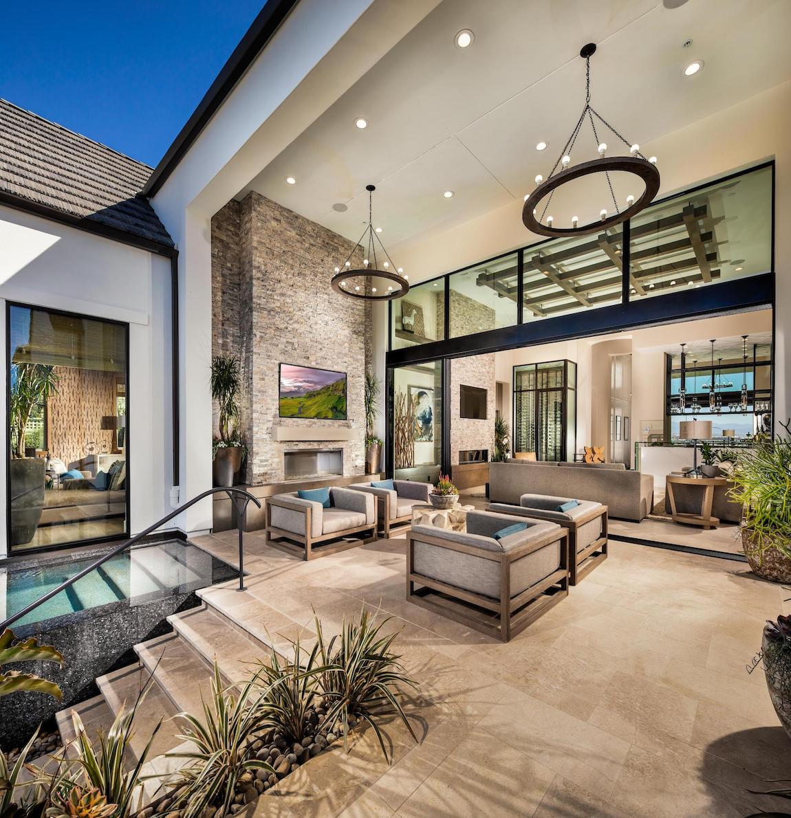 Stunning outdoor space highlighted by dual ring lighting fixtures