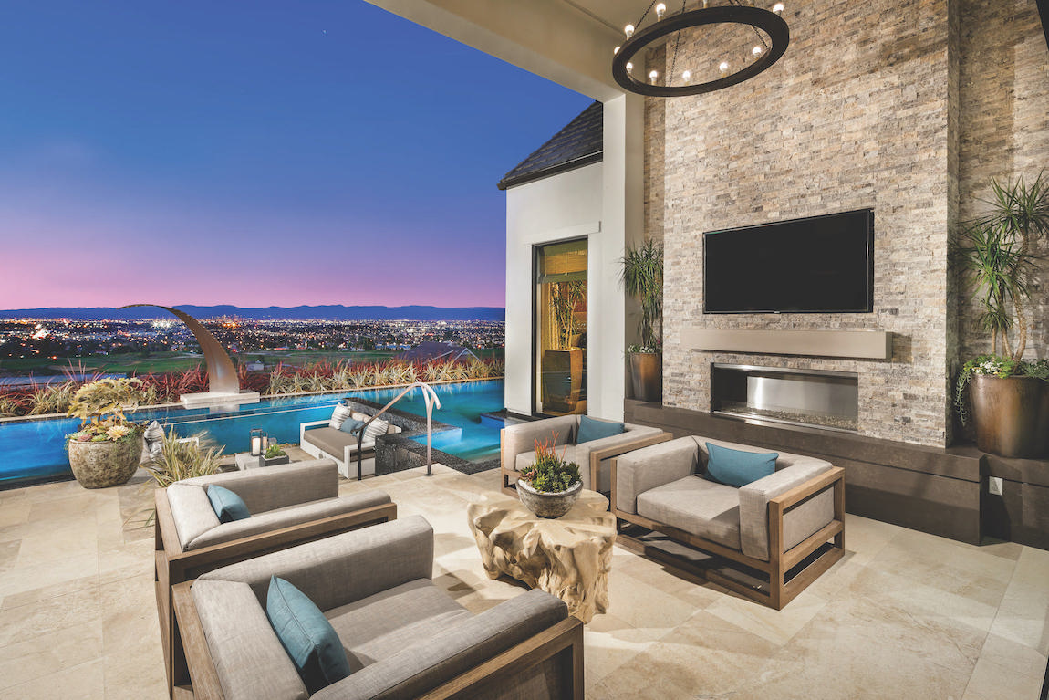 Lovely patio featuring lounge area with tv and sunken poolside seating space