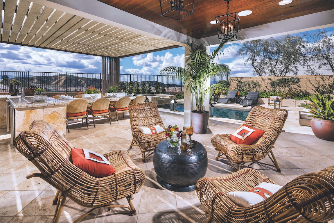 Luxury outdoor patio featuring lounge area and dining space