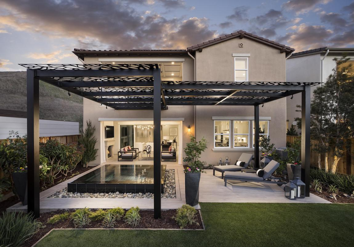 Luxury backyard featuring hot tub and inspired metal canopy