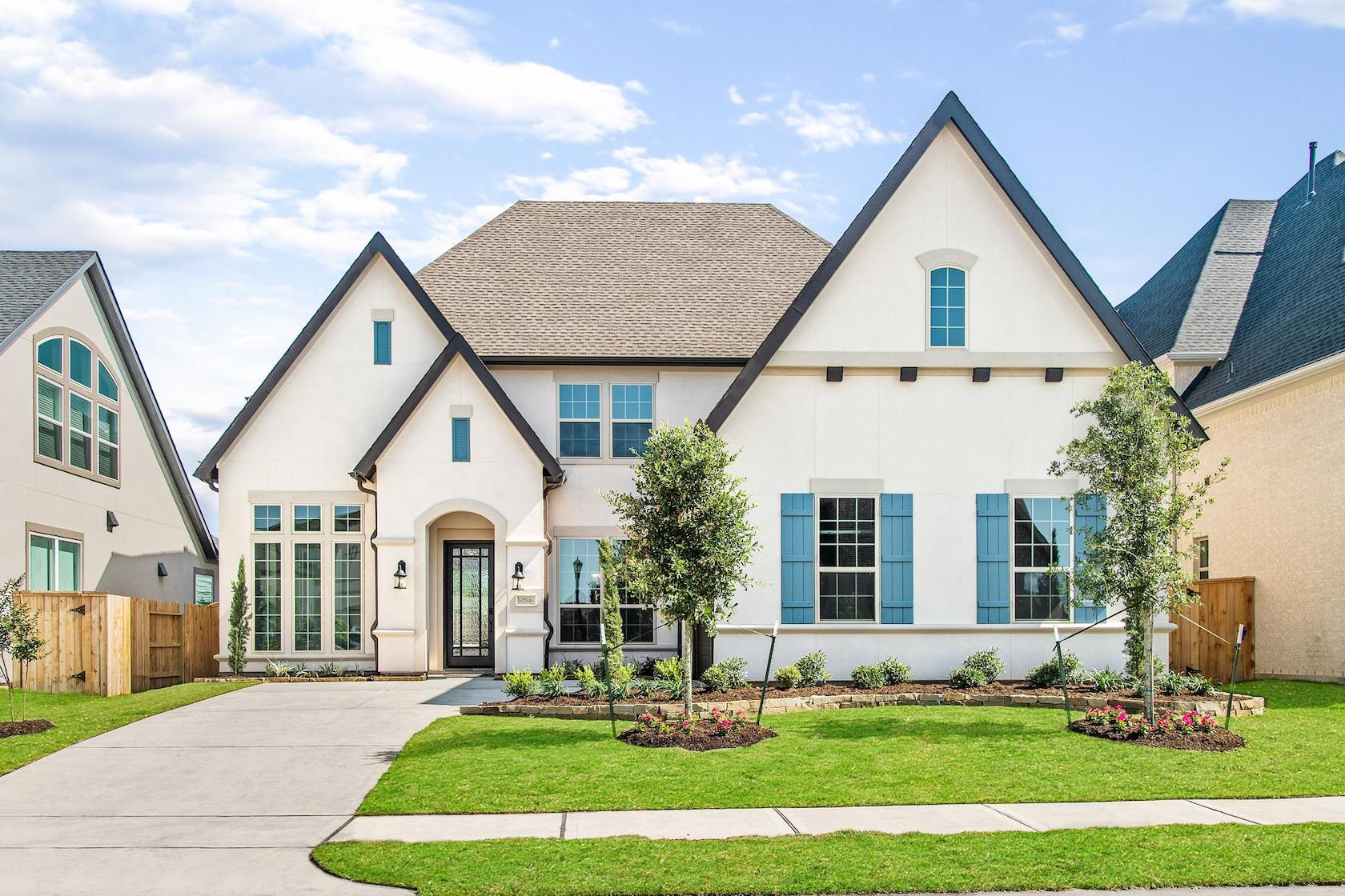 White front exterior with teal window shutters