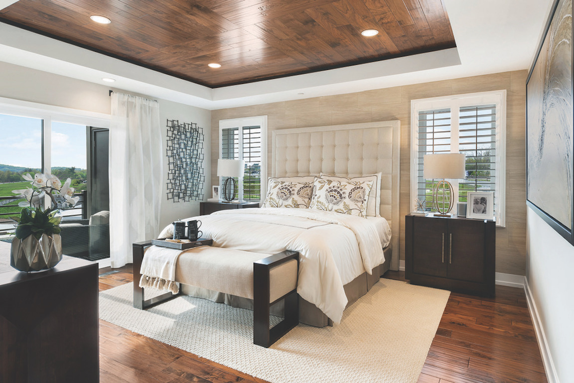 Feng Shui bedroom featuring centered bed with padded bed frame
