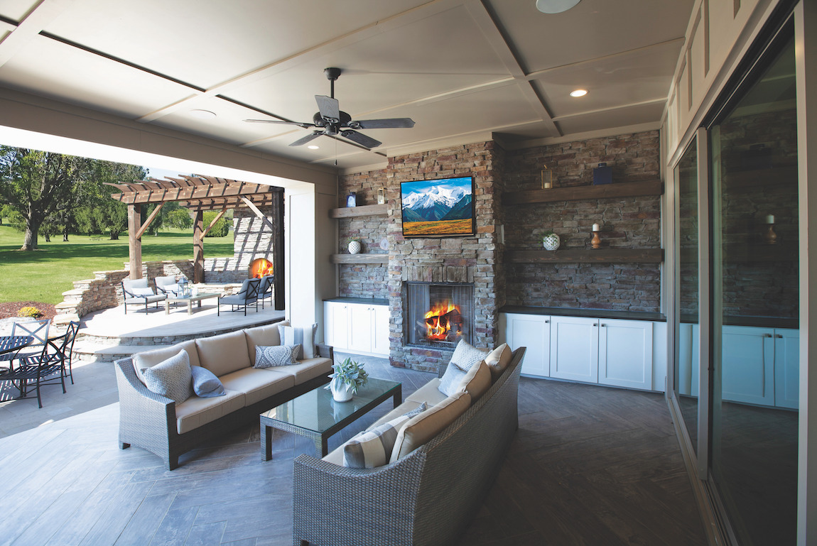 Luxury outdoor room featuring viewing area and fireplace