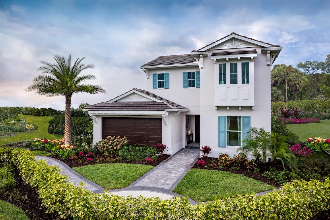 White front exterior of Florida home with teal window shutters and a brown one-car garage
