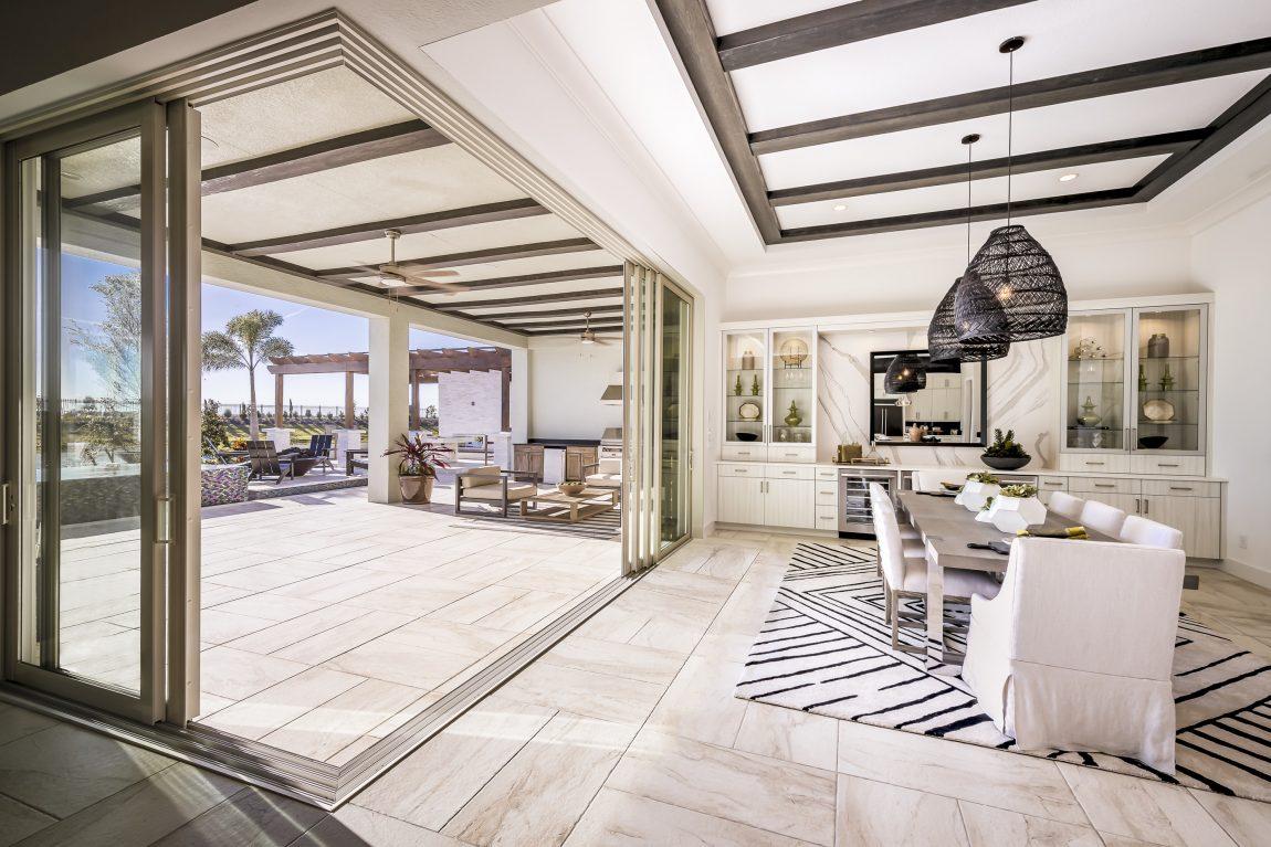 Luxury indoor-outdoor room with sliding glass doors