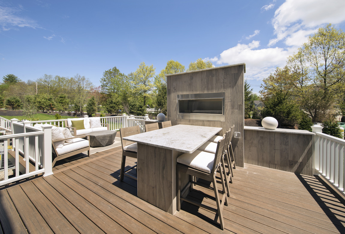 Spacious deck with lounge and dining areas