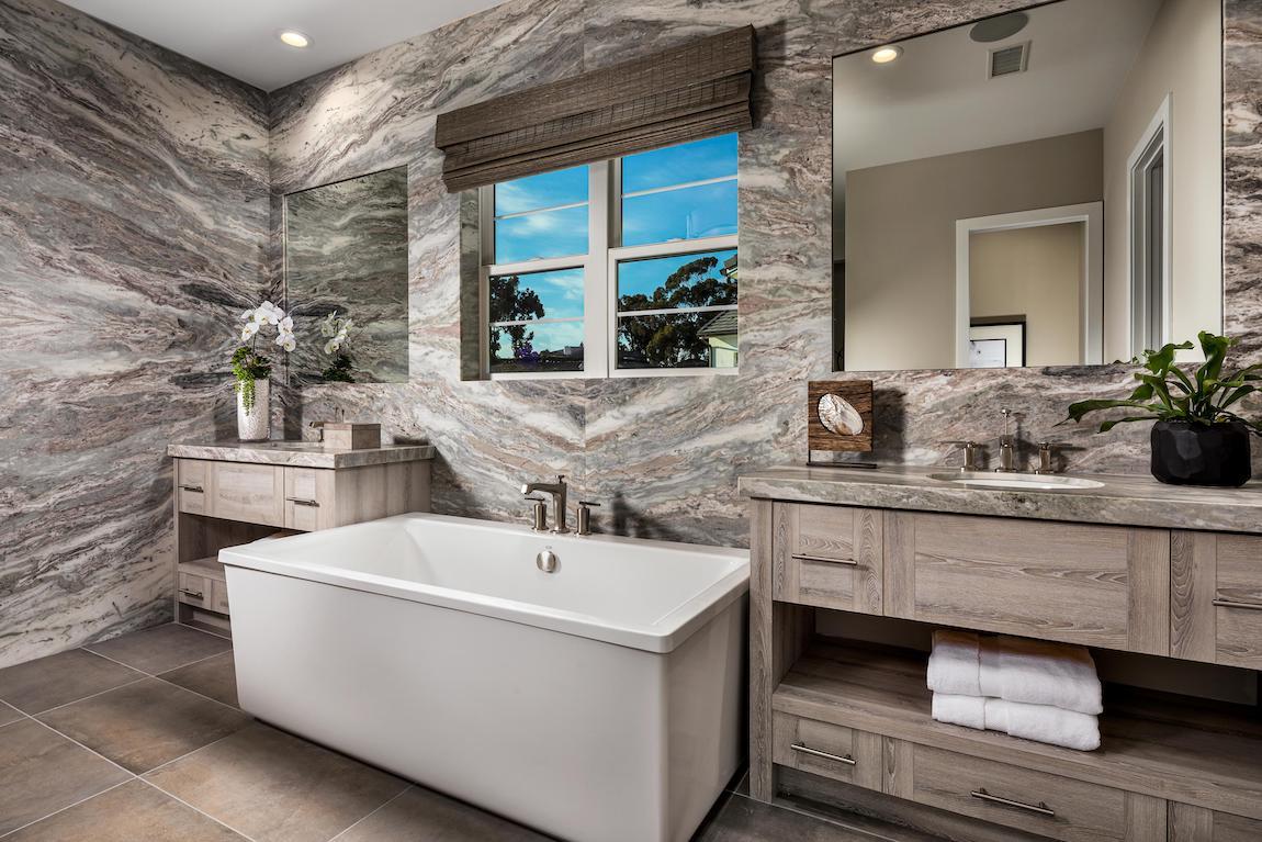 Margaux bathtub nestled in between two vanities