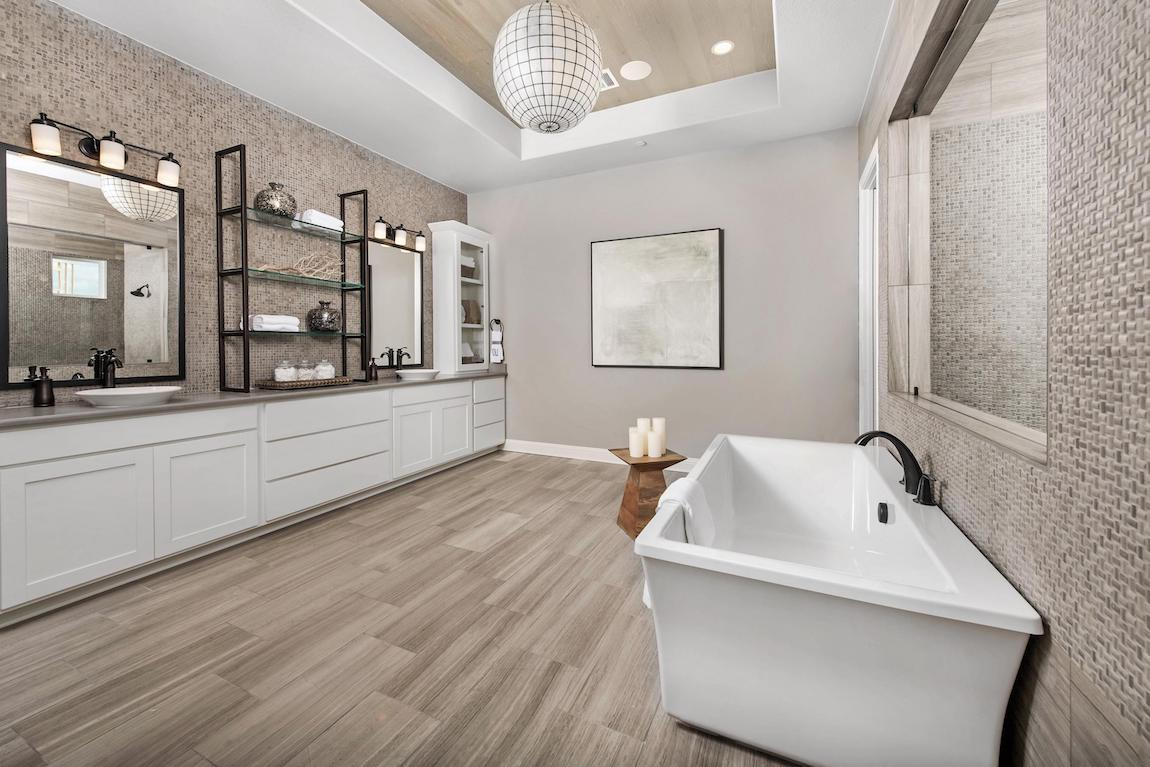 Stunning daul vanity design with middle shelving and Artifact design sink faucets.