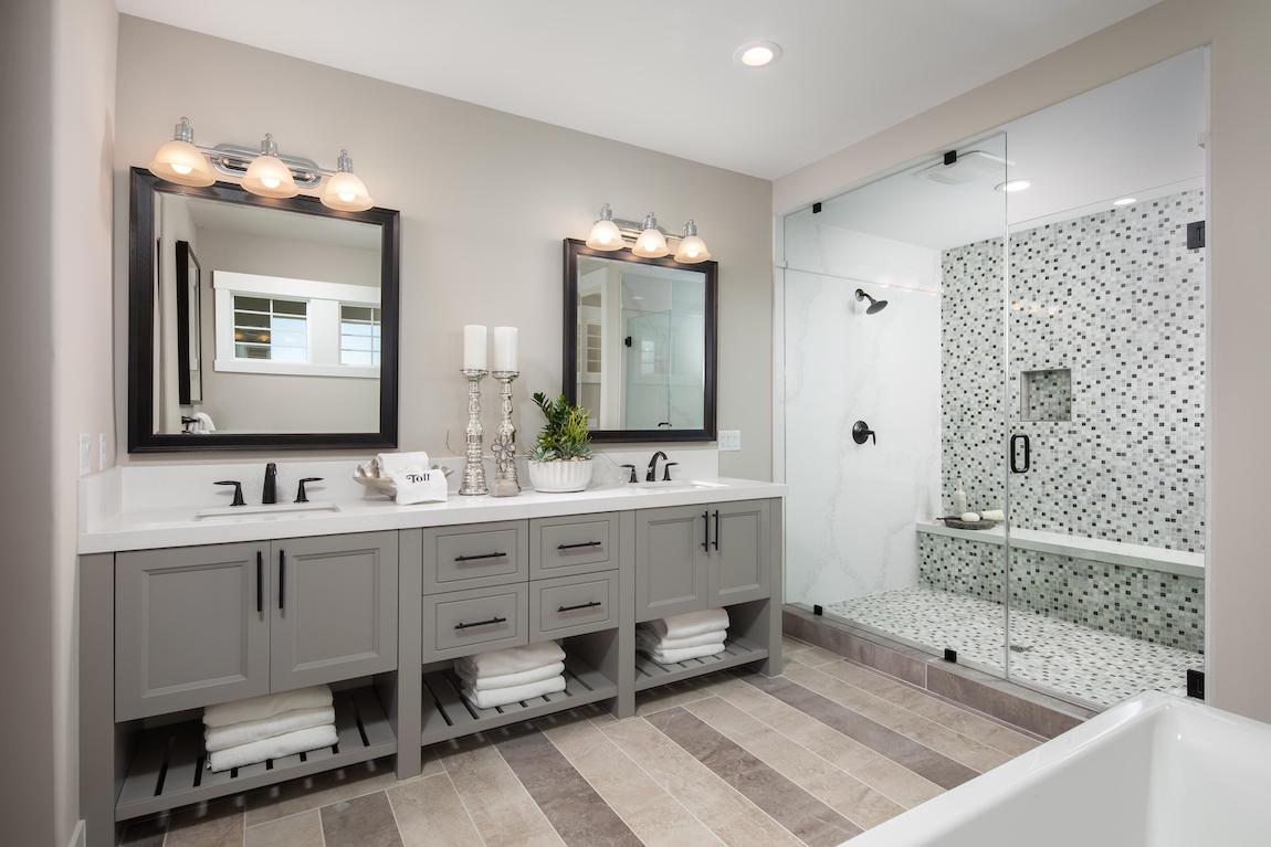 Dual vanity display featuring two sinks with a purist faucet design