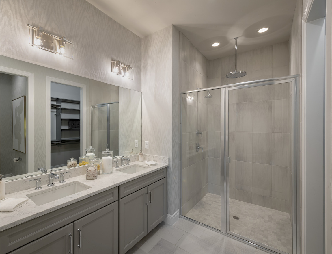 Large vanity with sizable mirror and two sinks.