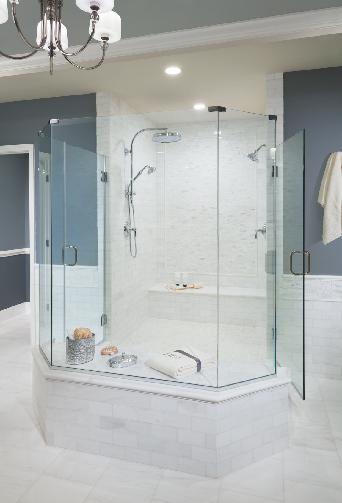 Luxurious showerhead in spacious shower.