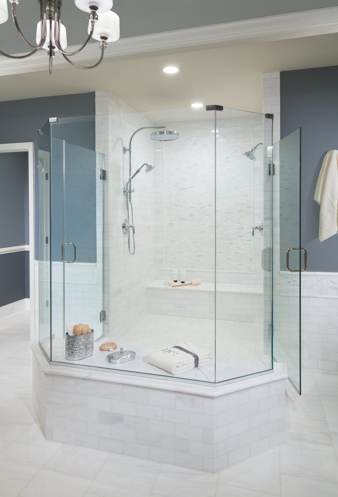 Luxurious showerhead in spacious shower.