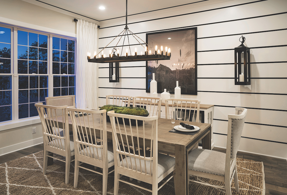 Modern dining space with rustic ambiance and charming tablescape