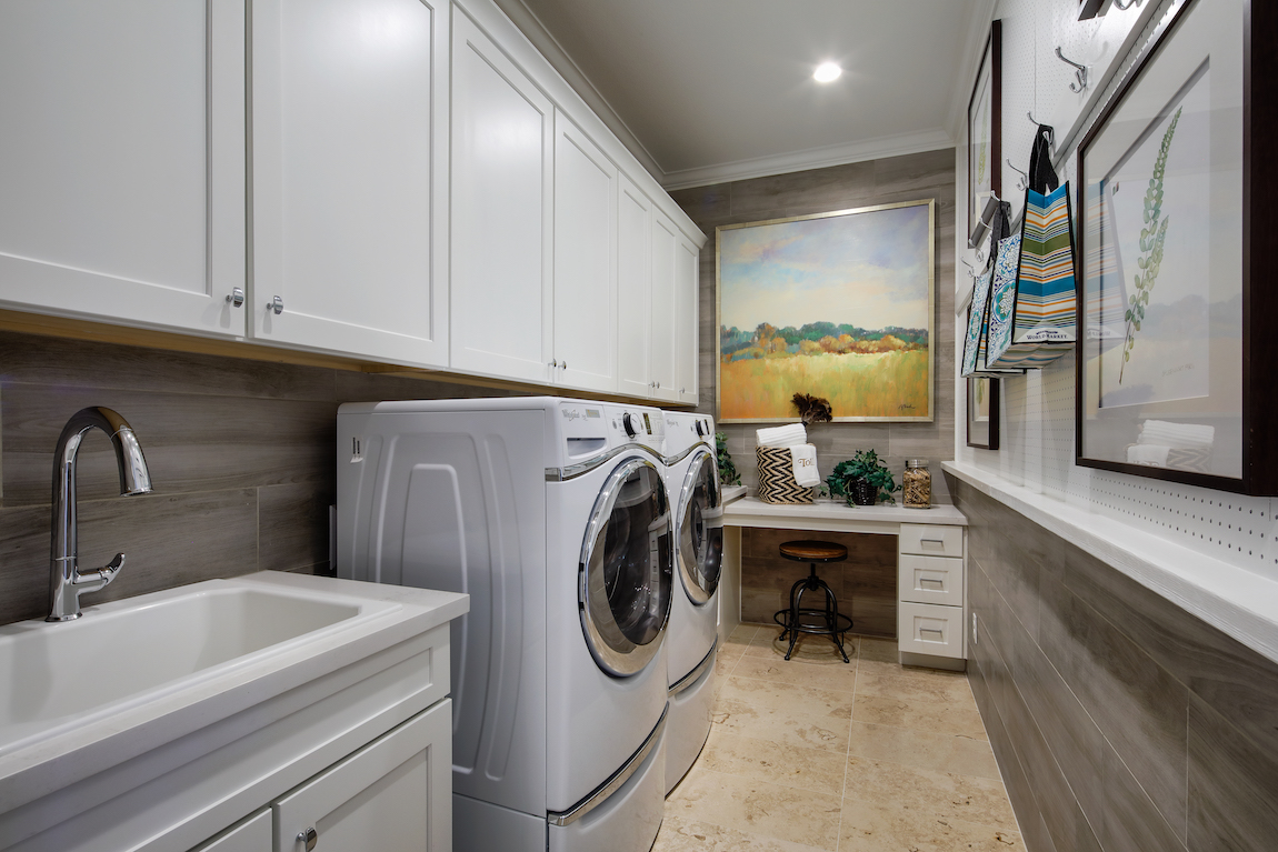 Laundry room with desk