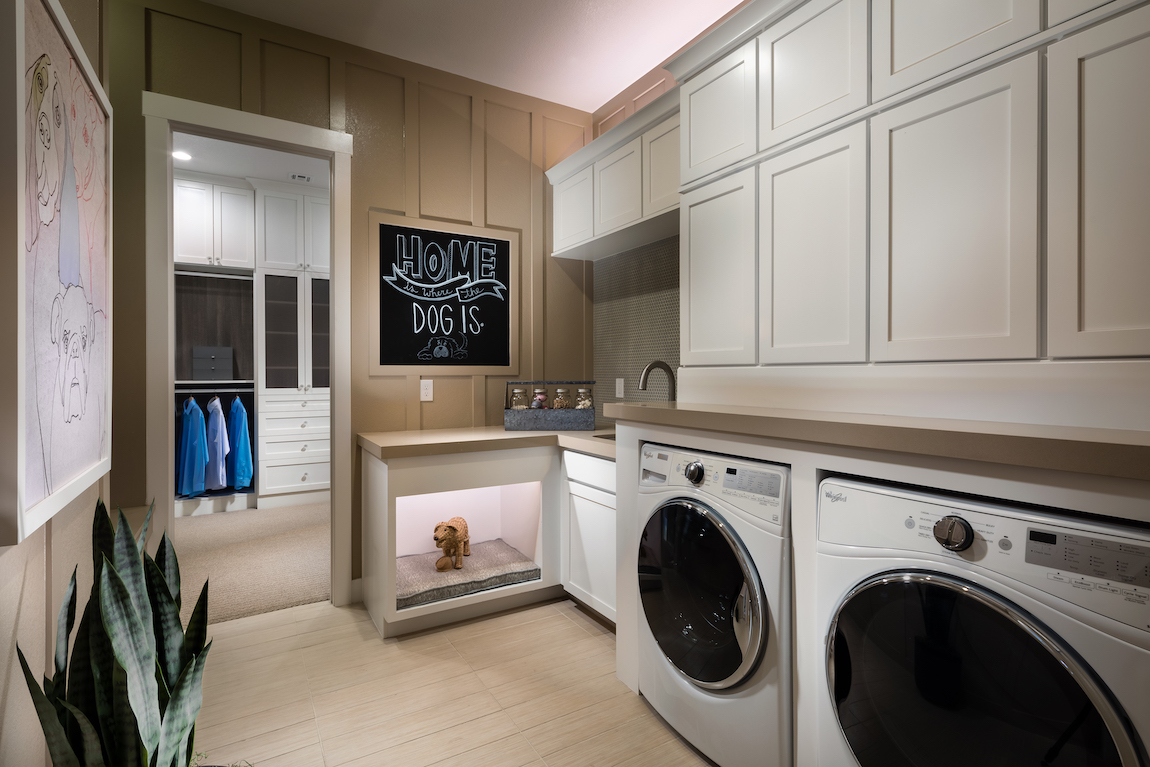 Laundry room with dog area, blackboard, and accent lighting