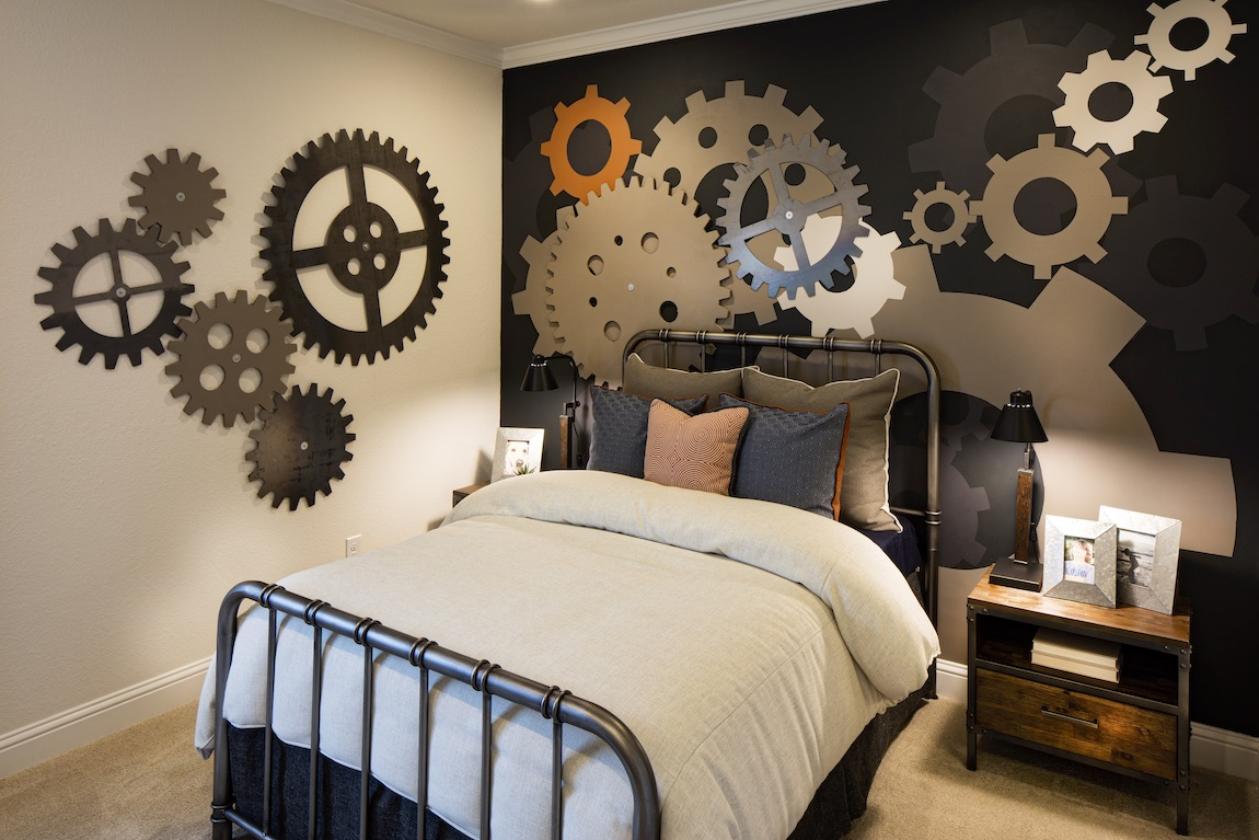 Bedroom with gears on wall and rustic decor.