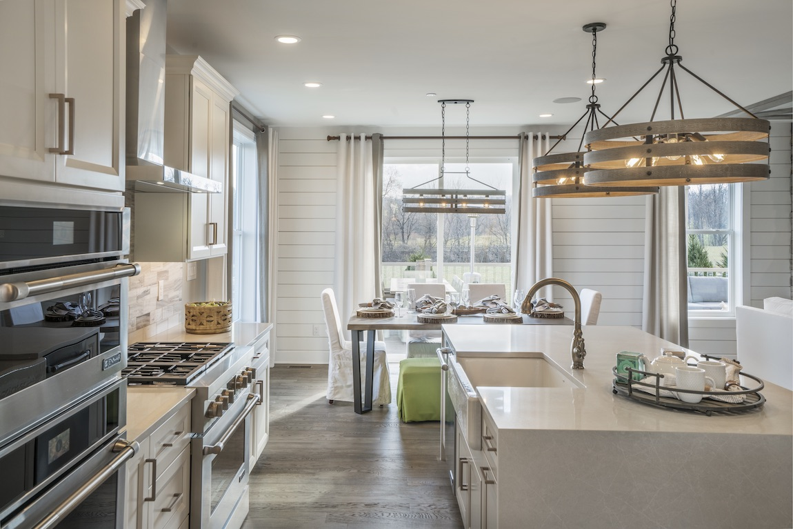 Kitchen with breakfast area and white countertops.
