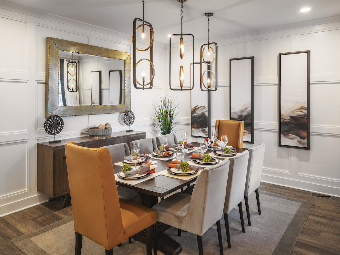Timeless dining room design featuring mix-and-match chairs and pendant lights