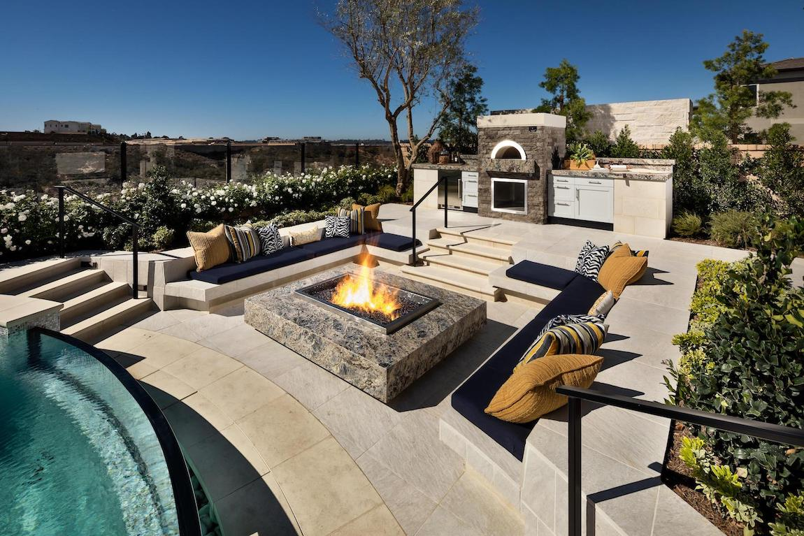 Outdoor seating area with granite fire pit