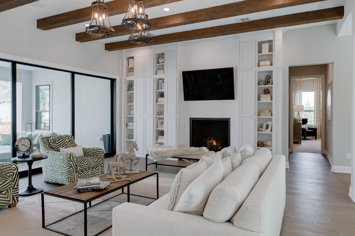 Light toned great room with wood beam ceiling accents