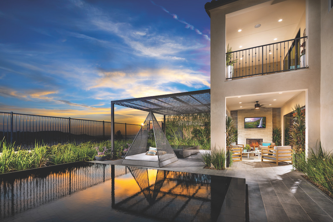 Gorgeous backyard with multiple outdoor rooms using exterior lighting with smart bulb technology