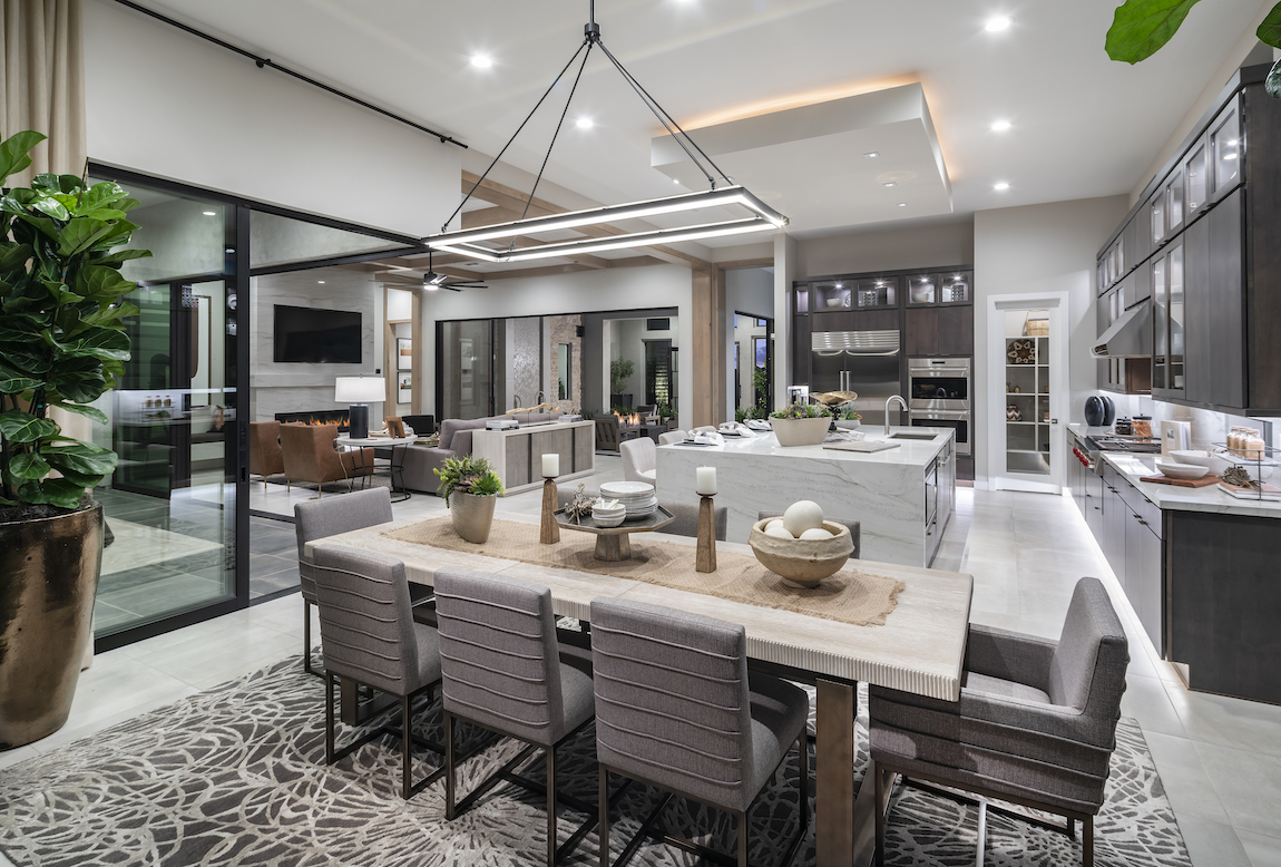 Open floor plan home design in Arizona with kitchen, dining room, and living room.
