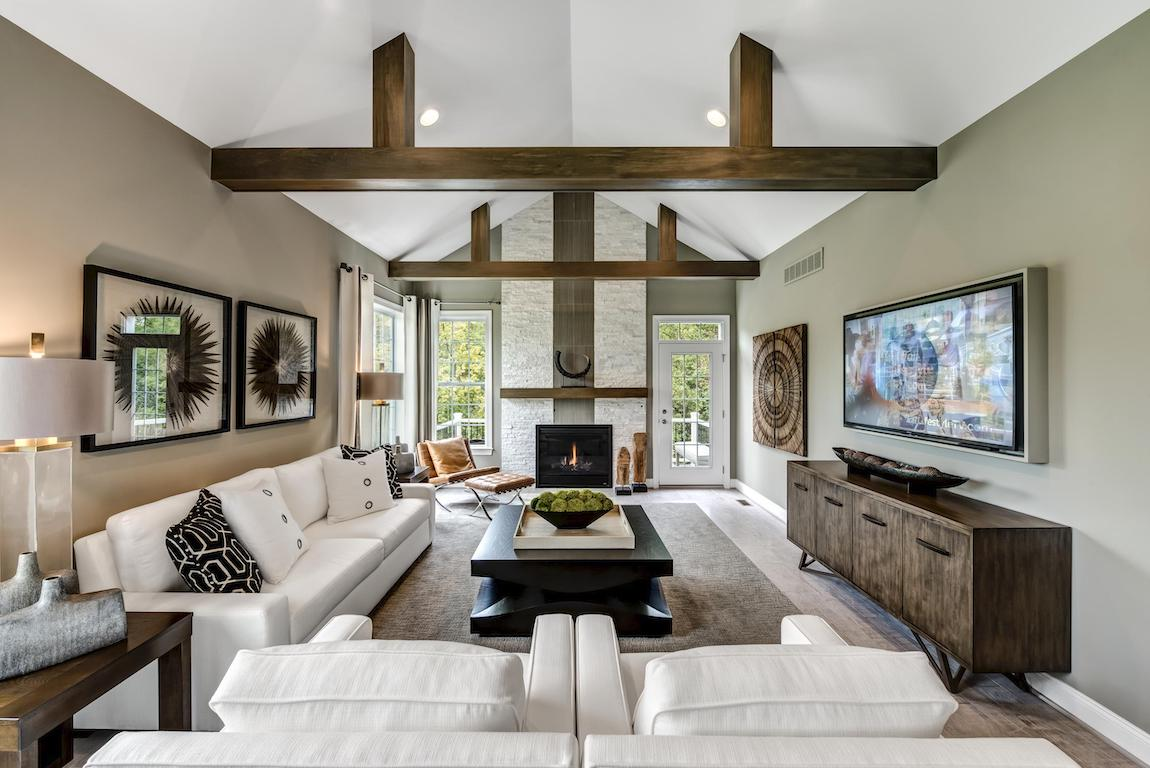 Great room featuring barn ceiling, a timeless architectural design