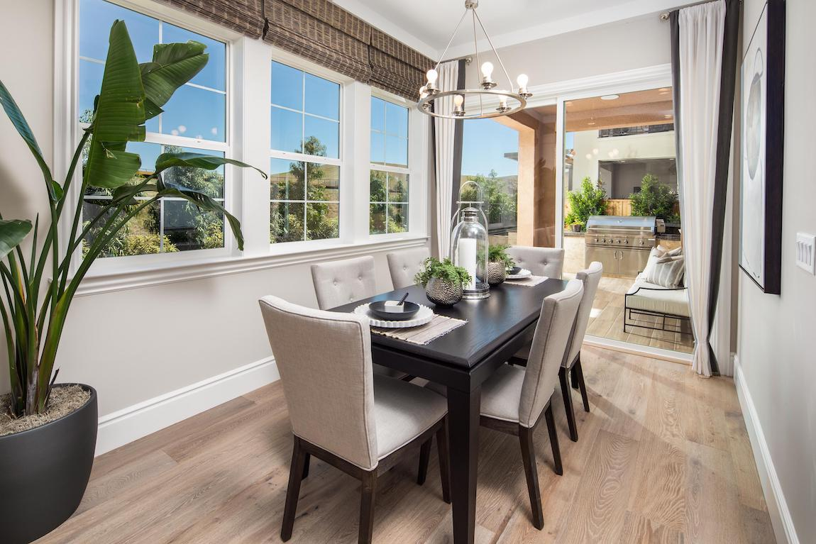 Dining room featuring natural elements such as wood flooring and plants