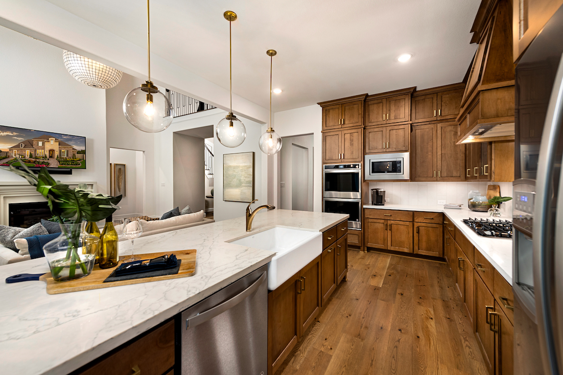 Kitchen with white countertops and wooden cabinets.